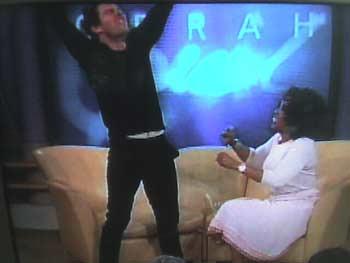 tom-oprah-exalting