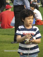 Coreaninho com celular