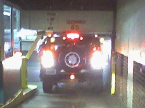 Hummer stuck in a parking garage