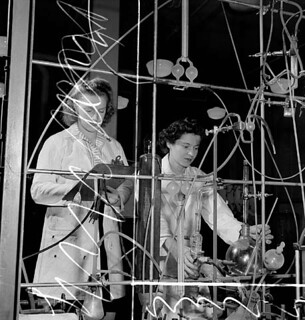 Two female laboratory workers test synthetic rubber in the Polymer Rubber Corporation plant. / À la Société Polymer Limitée, deux employées font des essais sur du caoutchouc synthétique