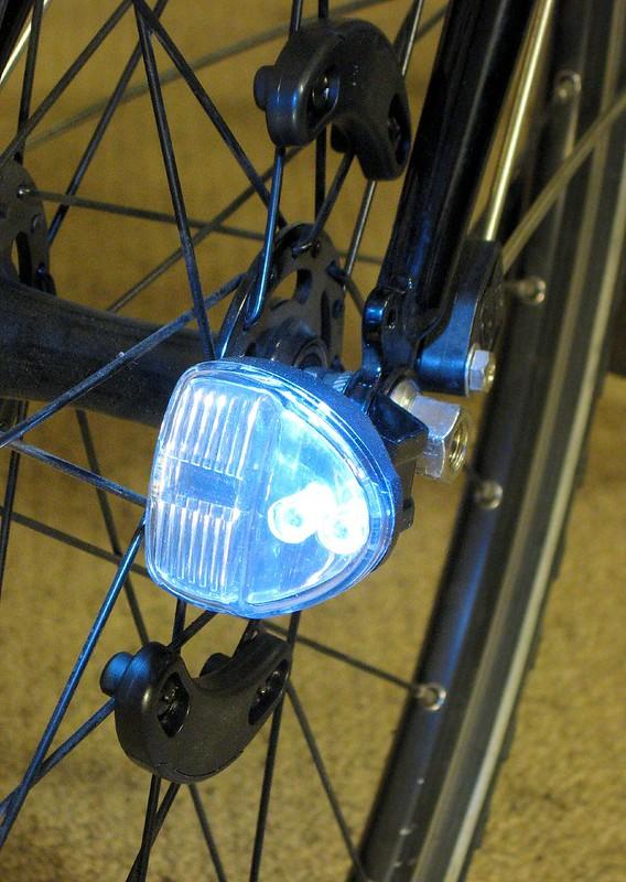 Reelight bike light on front wheel