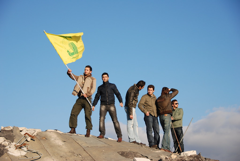 posing with hezbollah flag