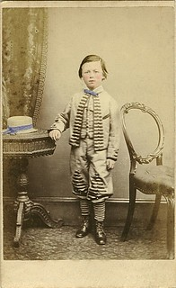 Boy with his straw hat on the table | by Antique Photo Album