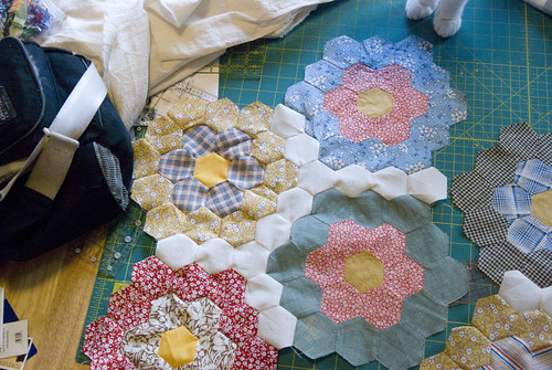 The goal: make an even blend of completely old and partially-new hexagons. In the end, if you can't tell which fabrics are vintage and which ones are reproduction, why should I tell you?