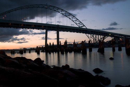 longexposure sunset clouds oregon river portland lights rocks pilings willamette fremontbridge