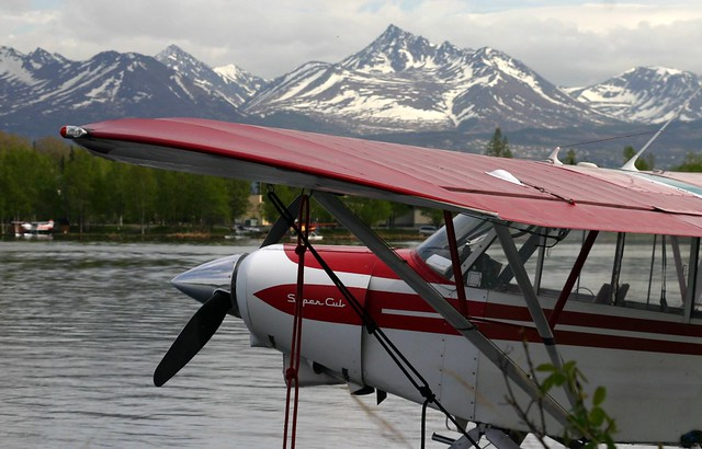 A Super Cub on Lake Hood with Pyramid Peak in the background