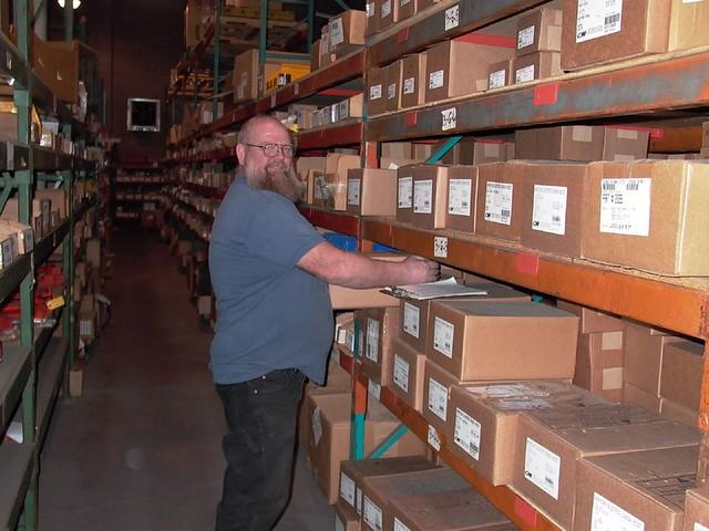 bd356f27f ... Jens Sorensen stocking shelves in the warehouse