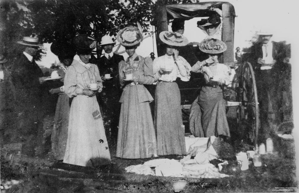 Group of men and women having a tea party at the Mackay sh… - Flickr