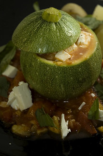 Courgette stuffed with tomato, feta and basil