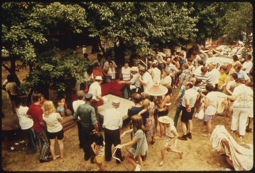 Audience at an Auction of Household Goods in a Residential Area. They Usually Are Held in the Summer Months to Sell Household Possessions of Retired People Who Are Moving to an Apartment, Or Who Have Died...