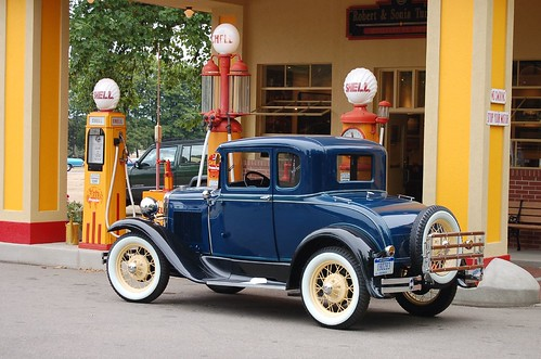 Model A Ford in front of antique gas pumps | by Corvair Owner