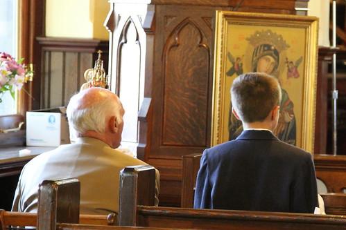 men praying in church
