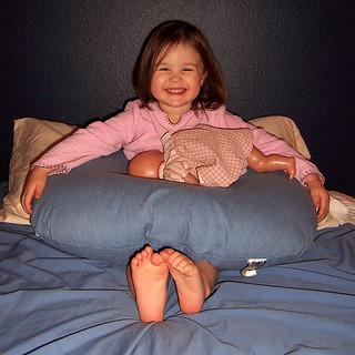 Ava nursing her doll