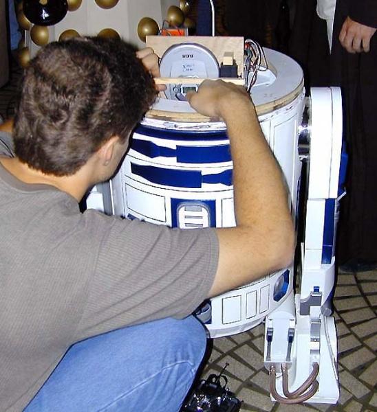 Dinorider repairs his droid