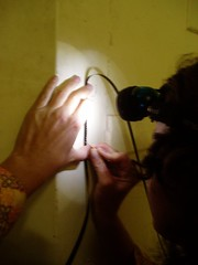 Vicki Smith scratching an improvised version of Line Describing a Cone on a bit of black super8 leader!   by bilateral