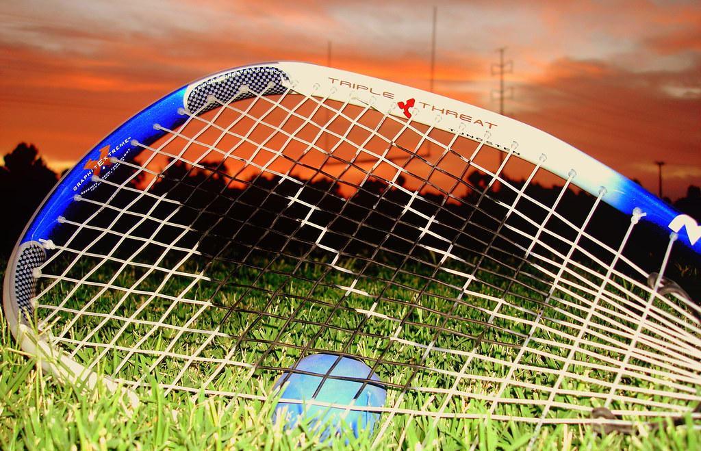 A racket and ball on the field