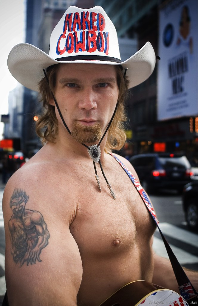 The Naked Cowboy Is Busking in a Face Mask During the