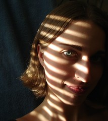 image of a women next to blinds