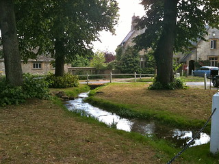 The brook running through Swinbrook Village   by Tip Tours