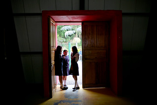 Student have a conversation in doorway   by World Bank Photo Collection