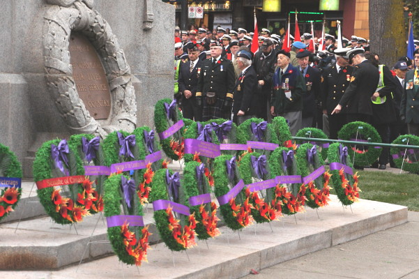 Remembrance Day 2010 in Vancouver Canada at Victory Square Cenotaph. Lest we Forget. Military Memorial.