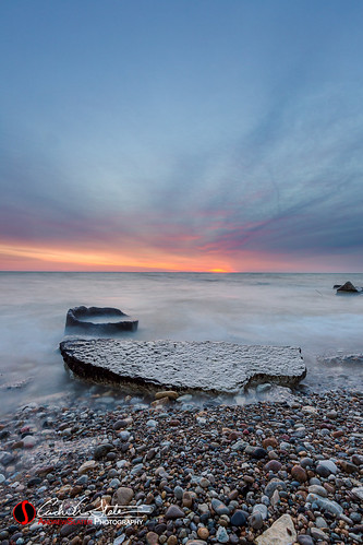 longexposure nature water clouds sunrise canon landscape rocks waves horizon lakemichigan shore lakefront kenosha landscapephotography discoverwisconsin southportpark travelwisconsin 5dmarkiii andrewslaterphotography wicounties