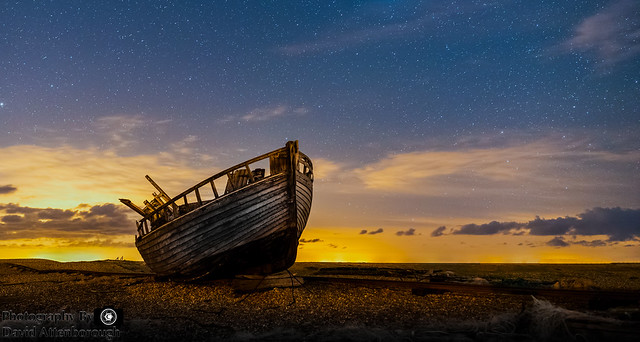 Old boat under the stars