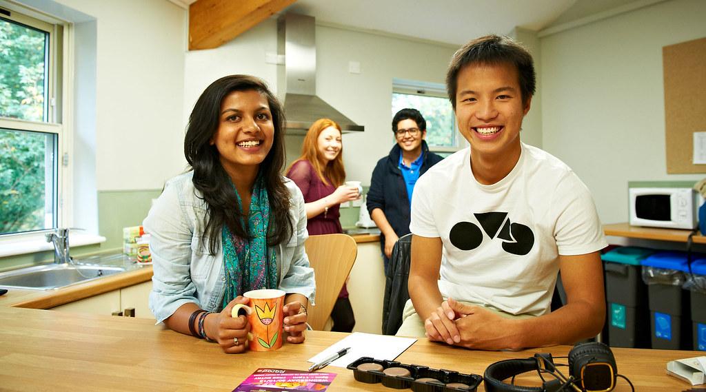 Students in their kitchen drinking tea