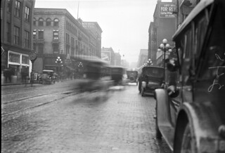 Cars driving on First Avenue near Madison, 1920