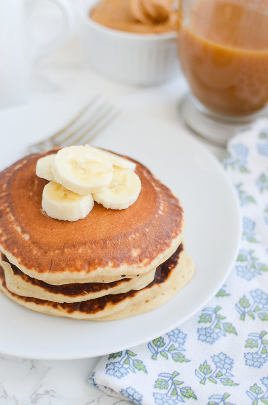 Peanut Butter Banana Pancakes - fluffy pancakes filled with creamy peanut butter and diced banana. Perfect for a relaxing weekend morning or prepping ahead for easy breakfasts all week!