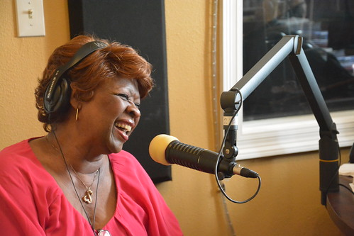 Irma Thomas pitches on the air at WWOZ. Photo by Kichea S Burt