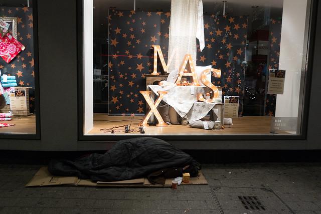homeless next to Christmas display