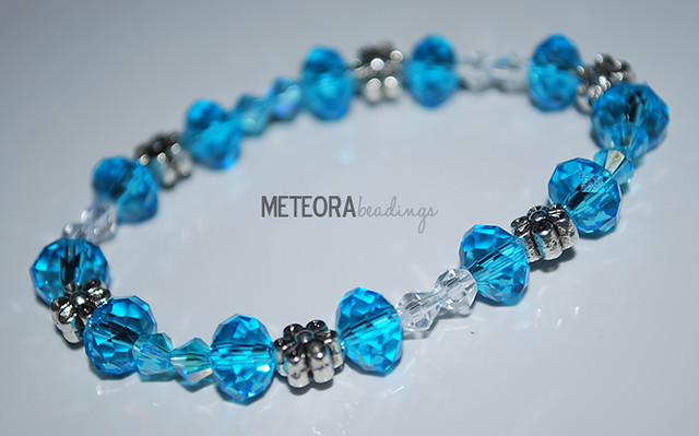 Bracelet - blue with small clear beads, with silver flower seperators