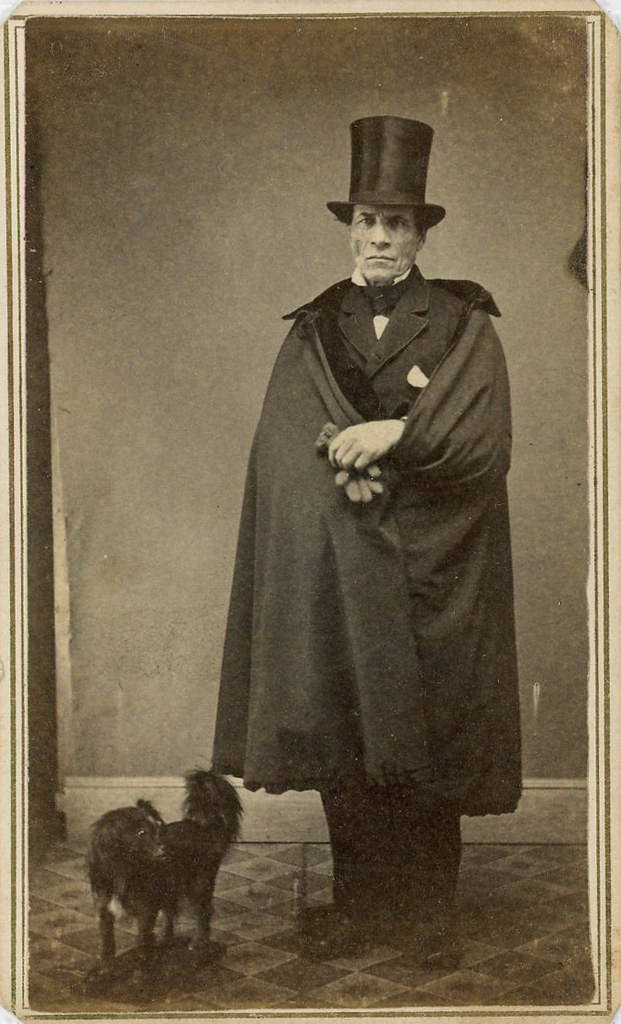 CDV of a man wearing a cape and top hat with a dog
