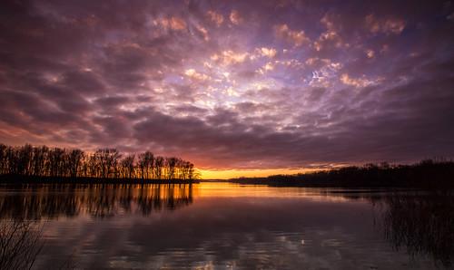 sunset sun reflection water clouds evening march pond michigan ottawa 2016 westmichigan ottawacounty thebendarea canon7dmarkii kevinpovenz ottawacountyparks