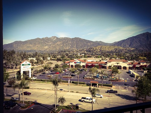 landscape urban city mountains sangabriel california monrovia outdoor mountainside road street ountain hill zajdowicz photoshop cellphone motorola droid turbo android smartphone cameraphone photoborder vignette building architecture roof trees palms automobiles cars sign letters words mountain foothill