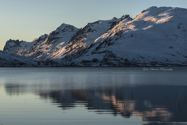 Mountains reflected in the fjord