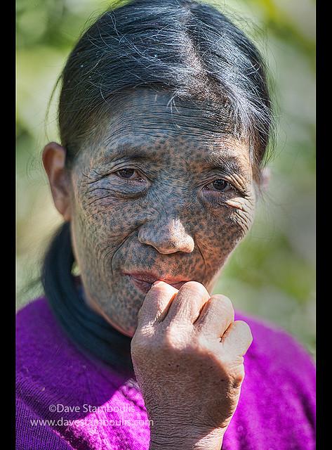 A Ngaya Chin (Daai) woman with face tattoo, Kanpetlet, Myanmar