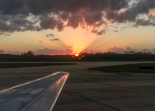 trees sunset sun southwest clouds airplane outdoors airport wing jacksonville jax runway 737