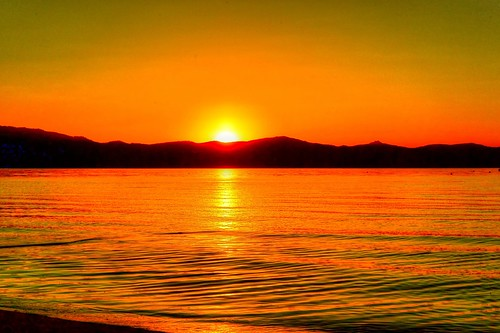 california sunset orange sun mountain lake water laketahoe alpine southlaketahoe waterpictorial joelach
