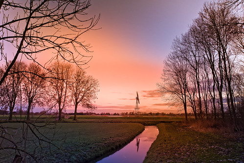 reflection sundown trees windmill oostwoud noordholland nederland nl nature tree sunset landscape dusk sky outdoors river silhouette sun sunlight scenics sunrisedawn autumn tranquilscene water beautyinnature grass