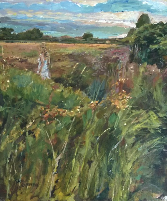 Woman passing through a field