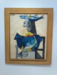 Zittende vrouw met vishoed- Pablo Picasso