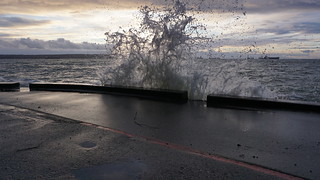 Watching waves crash against the seawall