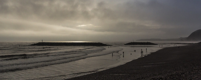 brave surfers and brooding skies