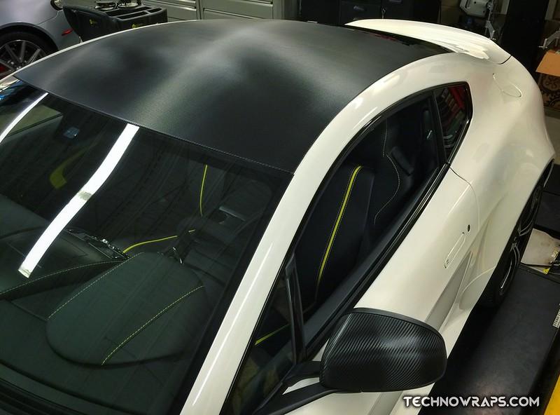 Car roof wrapped in black carbon fiber vinyl