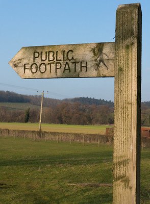 A wooden sign reading 'Public footpath'
