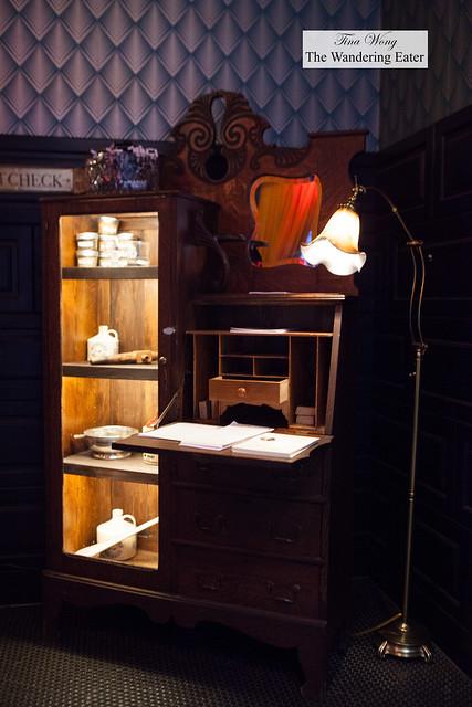 Vintage desk filled with Flatiron Room items