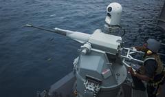 Gunner's Mate 3rd Class Achaad Abernathy fires a MK 38 25mm MOD 2 machine gun during a live-fire exercise aboard USS Carl Vinson (CVN 70) while underway for sea trials. (U.S. Navy/MCSN Daniel P. Jackson Norgart)