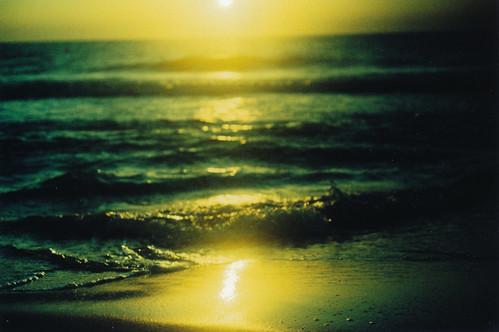 ocean light sunset sea reflection green film beach gulfofmexico water yellow analog 35mm evening xpro crossprocessed sand waves dusk slidefilm depthoffield naples dreamy tungsten analogue canona1 fujichrome vignette filmgrain fromthearchives 64iso fujichrometungsten64ttypeii bluemoonprint winterabort